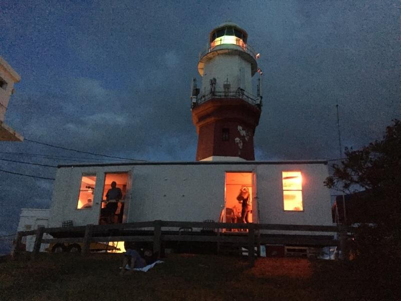 Instead of a race committee boat, the finish line team mans a trailer set directly beneath St. David's Lighthouse where they can observe the finish line offshore - photo © John Burnham