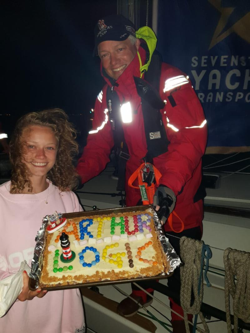 Mike Irwin, doctor on board Arthur Logic, receives a huge welcome home and cake baked by his daughter Hannah - photo © Arthur Logic