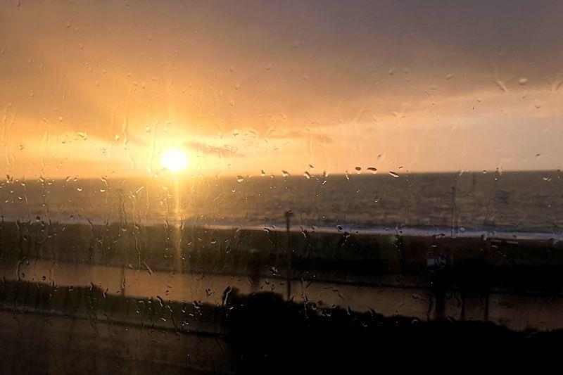 Sunrise in the last of the rain from Storm Deirdre - photo © Vicky Cox