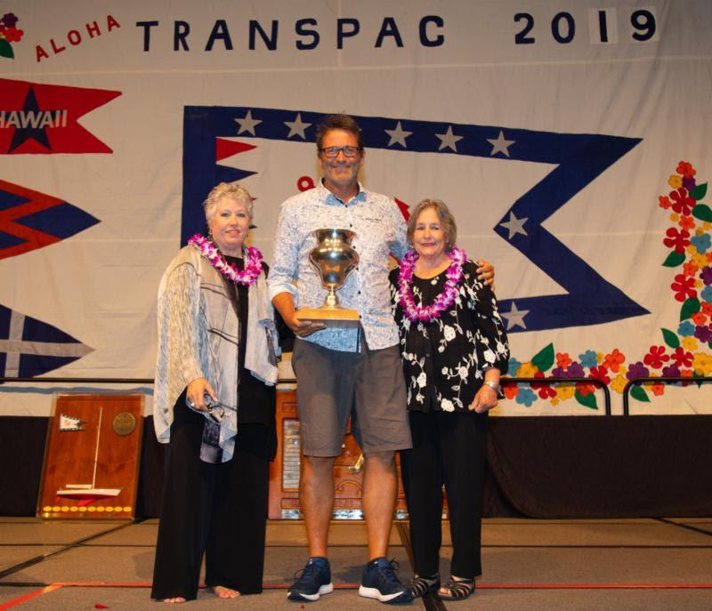 Dallas Kilponen from Kialoa II receiving the Burla Trophy with Michele Burla Parker and Pam Burla - Transpac 50 - photo © Sharon Green / Ultimate Sailing