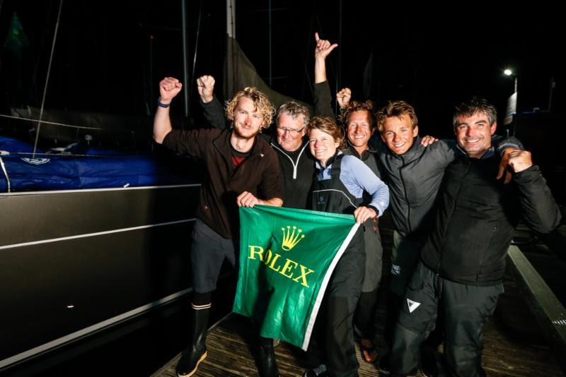 The crew of Foggy Dew celebrate the end of a successful race. Noel Racine's fourth class win out of eight Fastnets. - 2019 Rolex Fastnet Race - photo © Paul Wyeth / www.pwpictures.com