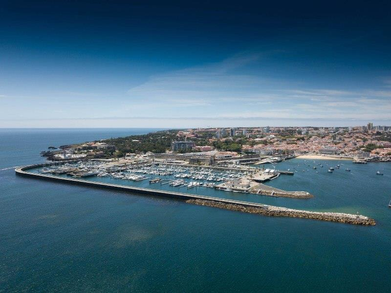 Star sailors and over 50 boats depart Cascais - photo © Marc Bow