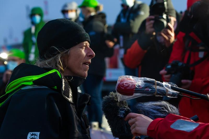 Skipper Miranda Merron, Campagne de France, is portraited being interviewed by media during arrival of the Vendee Globe sailing race photo copyright Jean-Marie Liot taken at