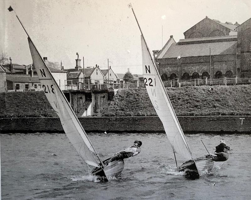 Michael Goffe, crewed by his younger brother Alan, sharped up his racing skills on the Thames. Here he is sailing N12 218, a Morgan Giles designed boat, just to leeward of 221, a Charles Currey 12 sailed by John Burgess and Jimmy Ledwith - photo © A Garrett