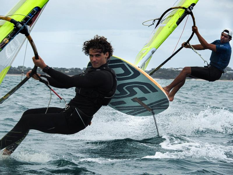Left- Romain Ghio (FRA), Right- Antonio Cozzolino (NZL) - 2020 RS:X Windsurfing World Championships, day 3 photo copyright Caitlin Baxter taken at Sorrento Sailing Couta Boat Club and featuring the RS:X class