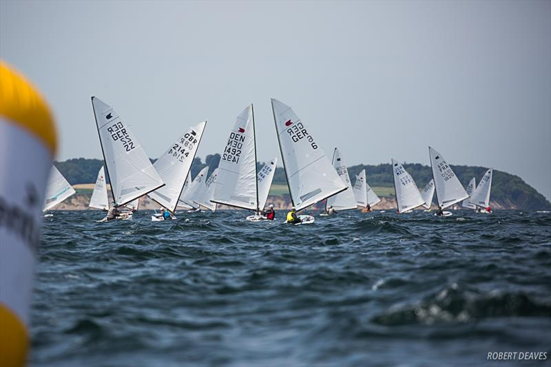 Downwind in Race 6 on day 3 of the OK Dinghy European Championship in Kiel, Germany - photo © Robert Deaves