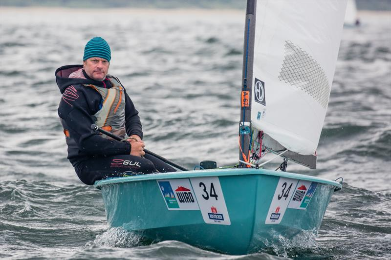 A content Jim Hunt on day 2 of the OK Dinghy World Championship - photo © Robert Deaves