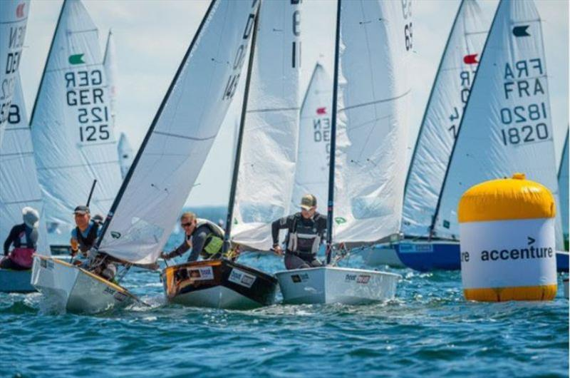 Close battles at the windward mark during the first race of OK European Championship.  photo copyright Kiel Week / Sascha Klahn taken at Kieler Yacht Club and featuring the OK class
