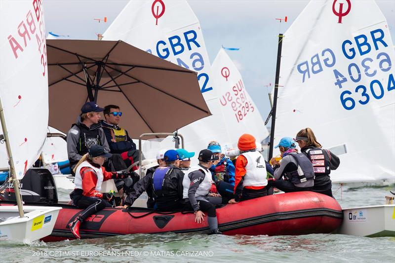 Lovely camaraderie on the water at the Optimist Europeans 2018 - photo © Matias Capizzano