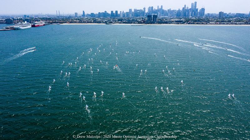 The Optimist fleet sailing in front of a now clear Melbourne skyline - 2020 Musto Optimist Australian and Open Championship - photo © Drew Malcolm