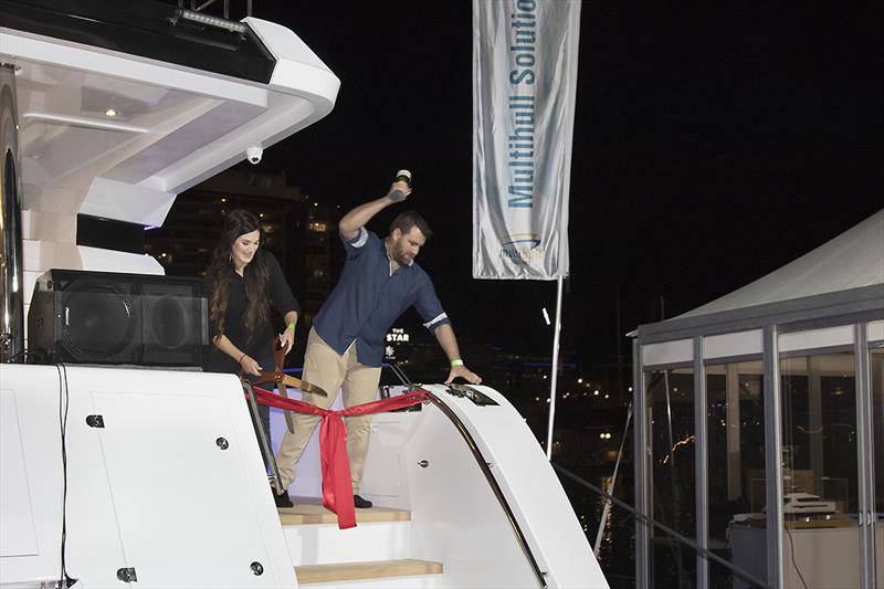 Christening the new ILIAD 70 at the Sydney international Boat Show - that Champagne bottle was not going to need a second attempt!!! - photo © John Curnow
