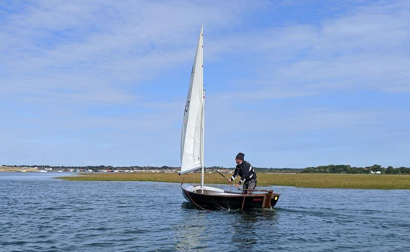 The 'dark lord' a.k.a. Andy Ash-Vie sailing his Scow at Keyhaven photo copyright Mark Jardine taken at Keyhaven Yacht Club and featuring the Scow class