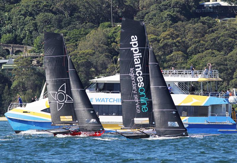 The two leaders set out on the final windward leg of the course in race 2 of the 18ft Skiff Spring Championship on Sydney Harbour - photo © Frank Quealey