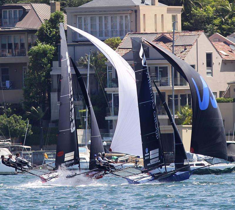 Smeg chases Winning Group to take over third place on the first spinnaker run during the 18ft Skiff NSW Championship final race - photo © Frank Quealey