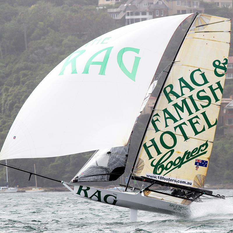 The Rag is barely touching the water on a wild spinnaker run on Sydney Harbour photo copyright Frank Quealey taken at Australian 18 Footers League and featuring the 18ft Skiff class