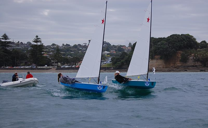 Match Racing, Murrays Bay, 2012. Jordelle Simkin (Taranaki) and Alice Noyer (Northland) battling for advantage while under close scrutiny from race judge Don le Page. Alice was the first female to win the event in its 32-year history. - photo © Brian Peet