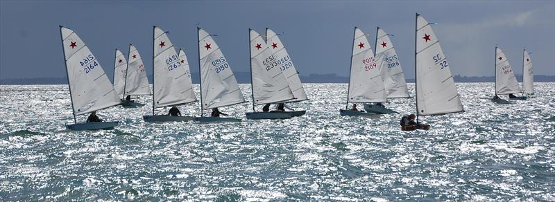 Starlings awaiting a heat start at the 2017 Nationals sailed at Wakatere Boating Club in 2017. Remarkably, the boat third from the right (#32) dates to the beginnings of the class in 1970, 47 years earlier. - photo © Brian Peet