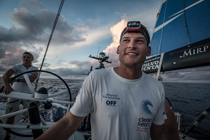 Henry Bomby enjoying the start of his off watch by watching the sun rise during Volvon Ocean Race Leg 8 from Itajai to Newport, day 9 on board Turn the Tide on Plastic photo copyright James Blake / Volvo Ocean Race taken at  and featuring the Volvo One-Design class
