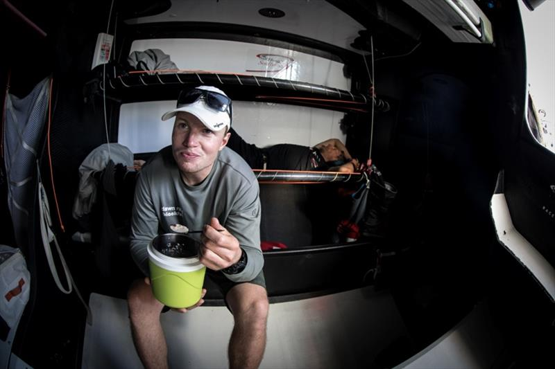 Volvo Ocean Race Leg 4, Melbourne to Hong Kong, day 11 Trystan Seal having breakfast on board Sun Hung Kai / Scallywag. photo copyright Konrad Frost / Volvo Ocean Race taken at  and featuring the Volvo One-Design class