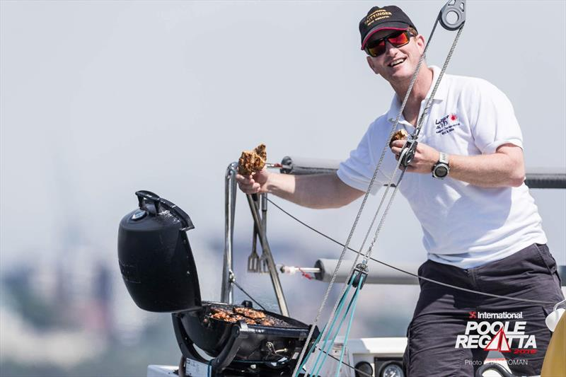 Ed Wilton barbeques while helming on Tom Tit during the International Paint Poole Regatta 2018 - photo © Ian Roman / International Paint Poole Regatta