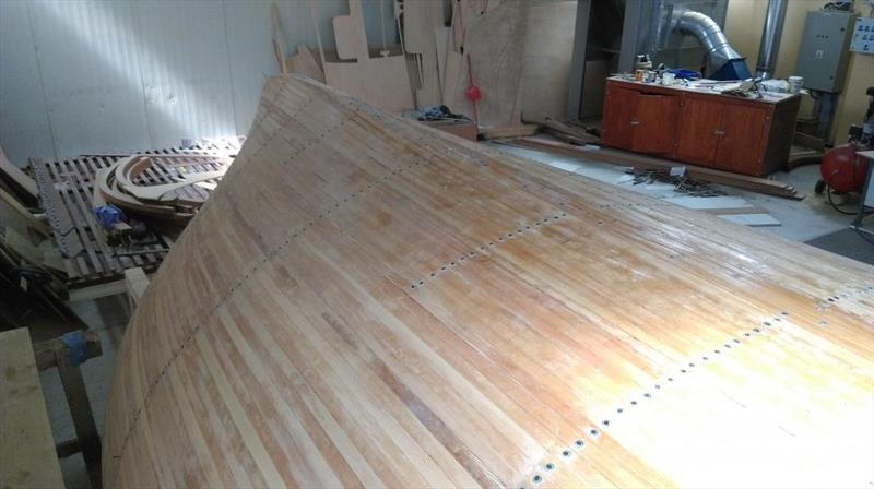 Croatian Gajeta build - The first rows of screws are in the process of being removed and the hull sanded to abrade back any squeezed-out epoxy - photo © West System International