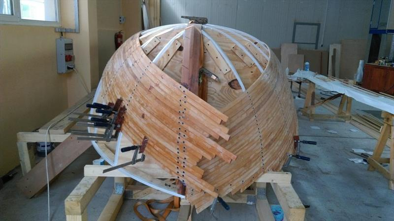Croatian Gajeta build - The hull takes shape, with the batons held in place with screws through washers - photo © West System International
