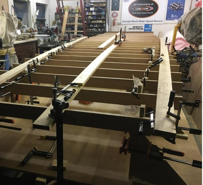 Supported by a metal frame, the first elements of the hydroplane's hull are being assembled (August 2018) - photo © West System International