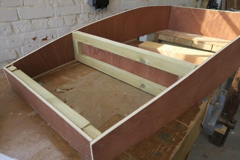The Mouse Boat has a curved bottom. Students achieve this by deflecting a wooden measuring batten in the middle to get the right amount of curve - photo © Wessex Resins & Adhesives