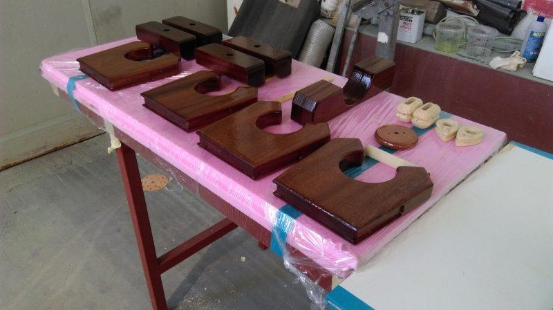 The shapes for the rowlocks, blocks and other functional pieces have been cut from solid mahogany photo copyright Wessex Resins & Adhesives taken at  and featuring the  class