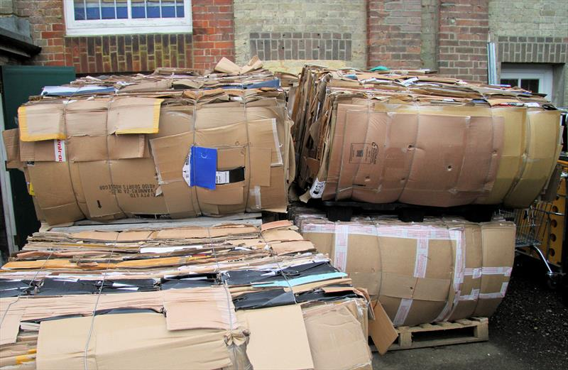 Palleted cardboard ready for recycling at Wetsuit Outlet - photo © Mark Jardine