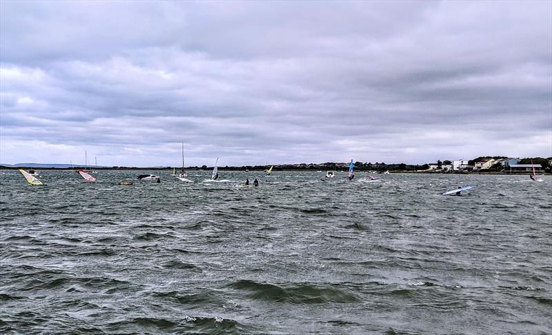 Christchurch harbour packed with windsurfers on Saturday photo copyright Mark Jardine taken at  and featuring the Windsurfing class